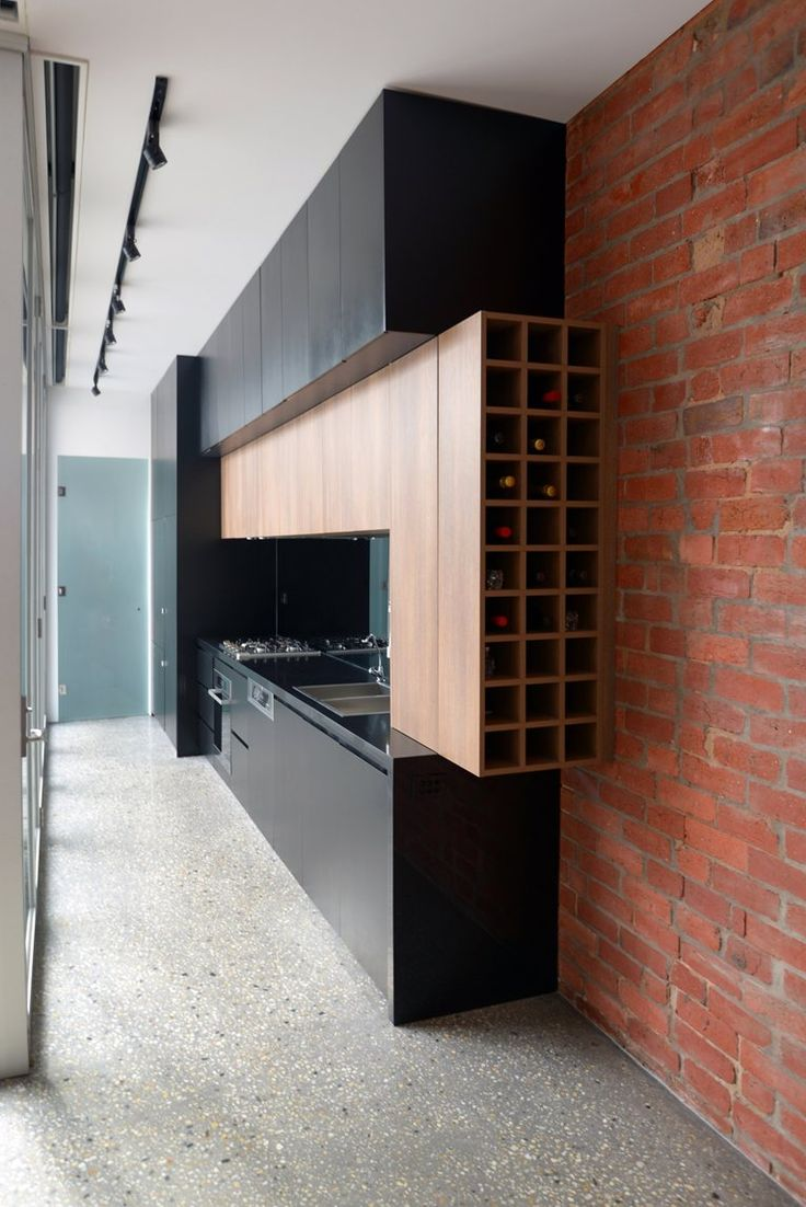 kitchen design modern kitchen ideas Love the use of brick wood and black matte surfaces to create this modern kitchen design kitchen love the contrast of the wood against the black