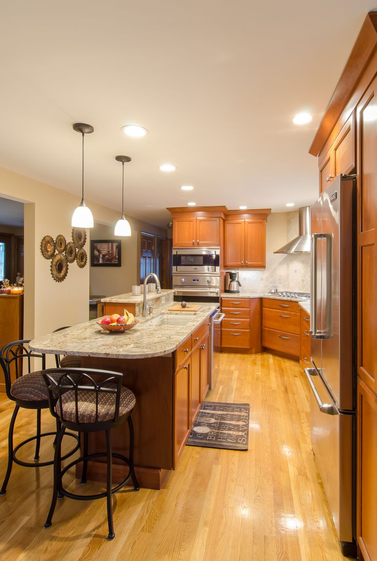 cherry wood cabinet kitchens cherry wood cabinets kitchen Cherry Kitchens stained cherry cabinetry granite countertop corner cooktop stainless steel appliances
