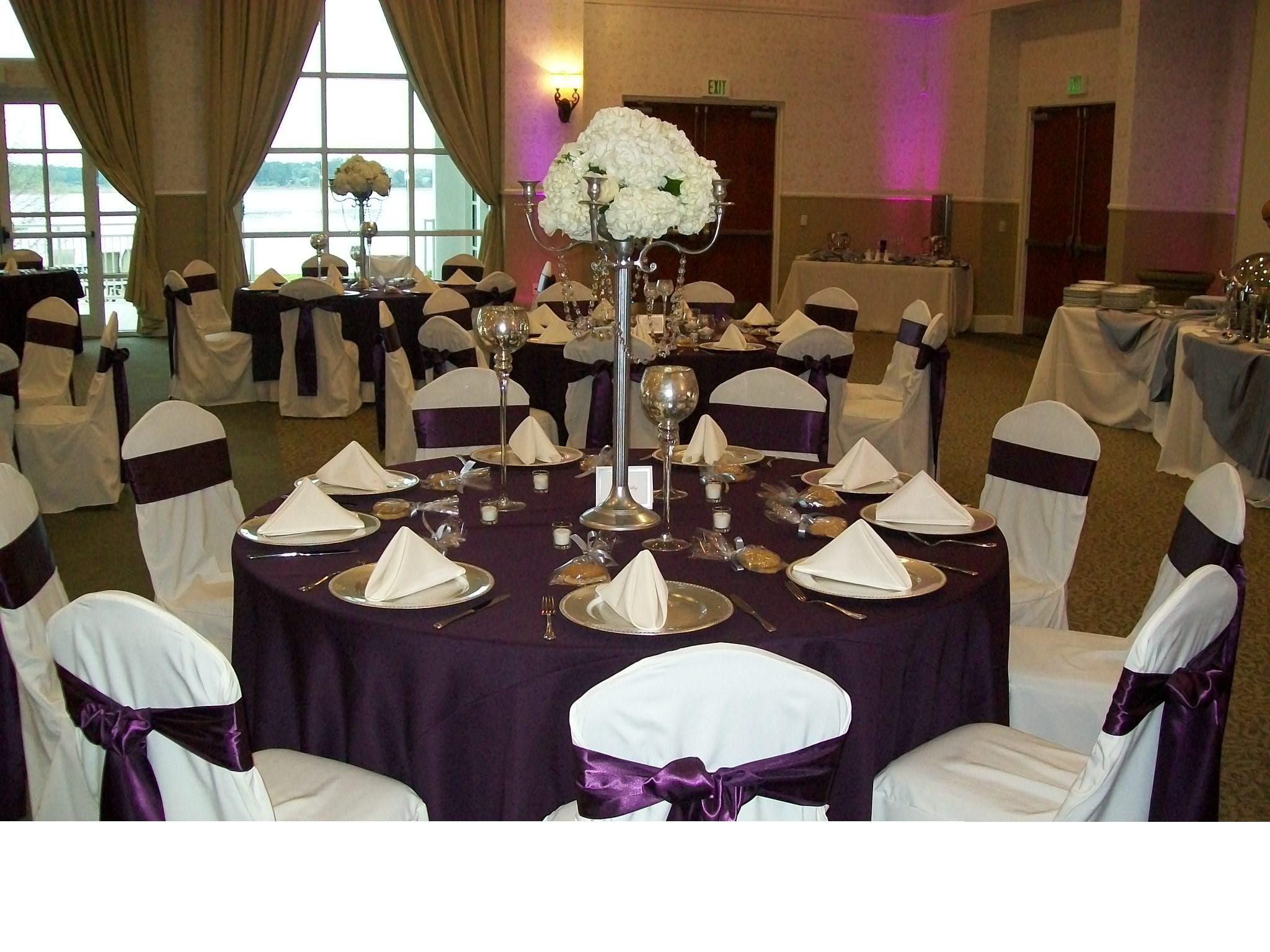 wedding and event linen rentals wedding linens White base linen with a full Eggplant Poly Overlay White Poly Napkins White Ballroom