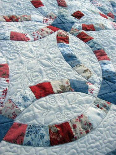 wedding ring quilt Double Wedding Ring quilt in French General Rural Jardin fabrics Close up of quilting at