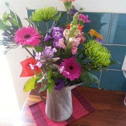 Rainbow Coloured Flowers in Tin Jug Love These Mixed All Together