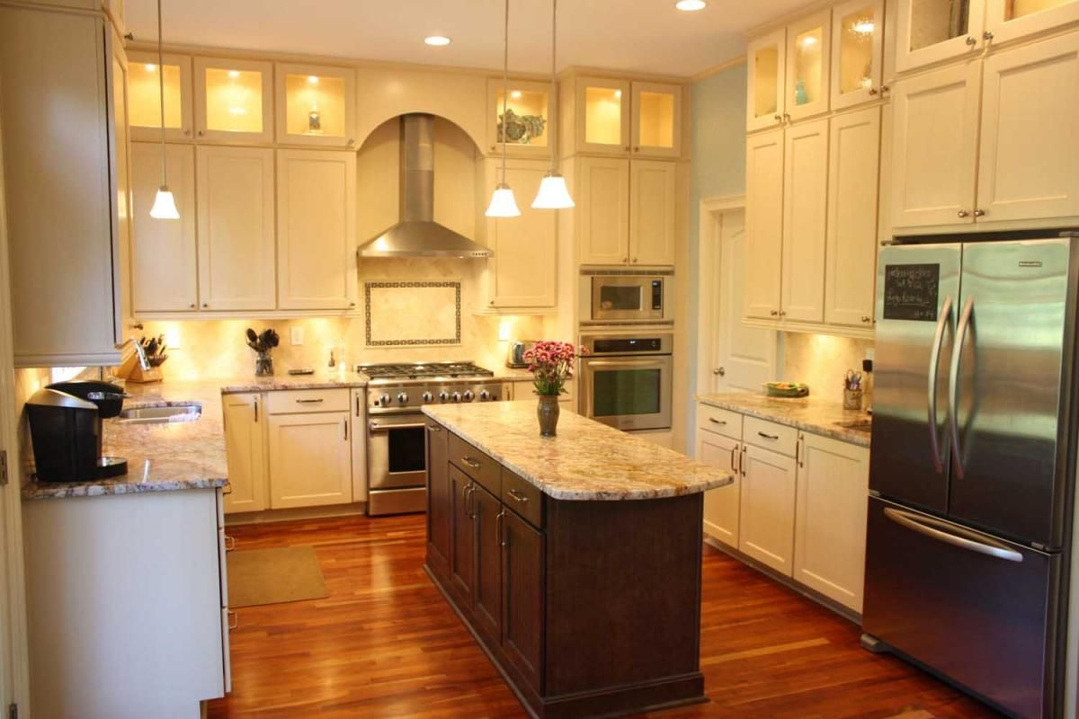 upper kitchen cabinets Platinum Kitchens Double stacked upper cabinets with glass and narrow island with seating