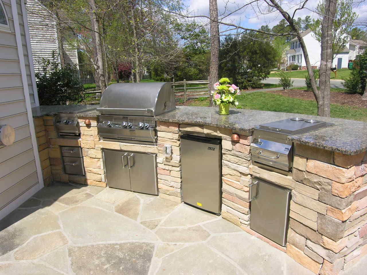 outdoor kitchen designs backyard patio with kitchen ideas This custom outdoor kitchen design has space for several outdoor