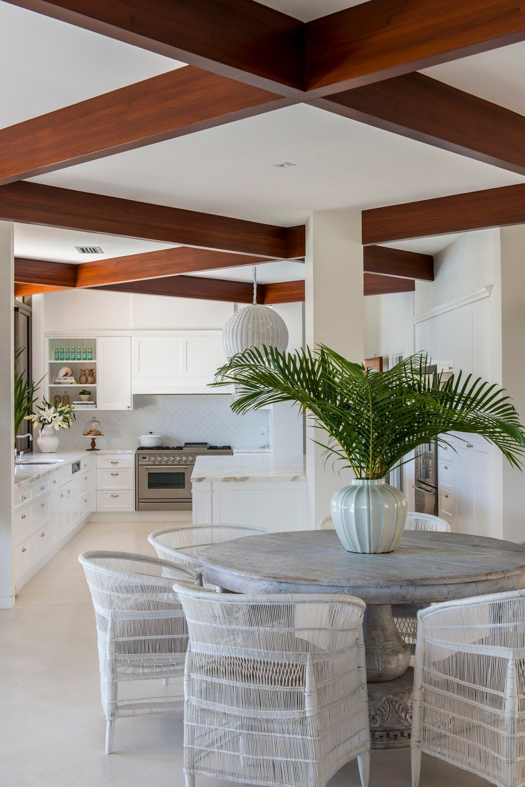 beachy kitchen table Malawi chairs and a round white washed table gorgeous Cottage KitchensBeach
