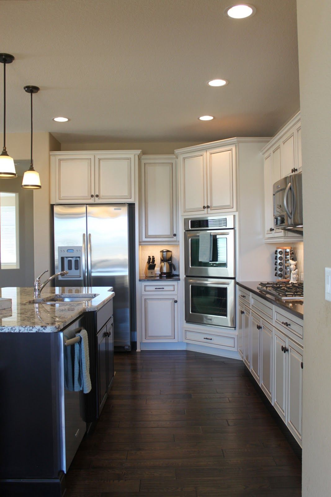 off white kitchen cabinets Love the white cabinets and wide plank floors