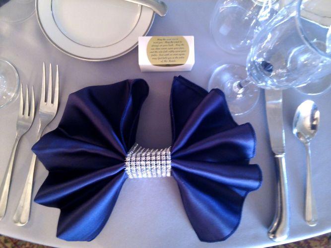 napkins for wedding Fun bow tie napkin fold with silver rhinestone napkin rings Wedding coordination by www
