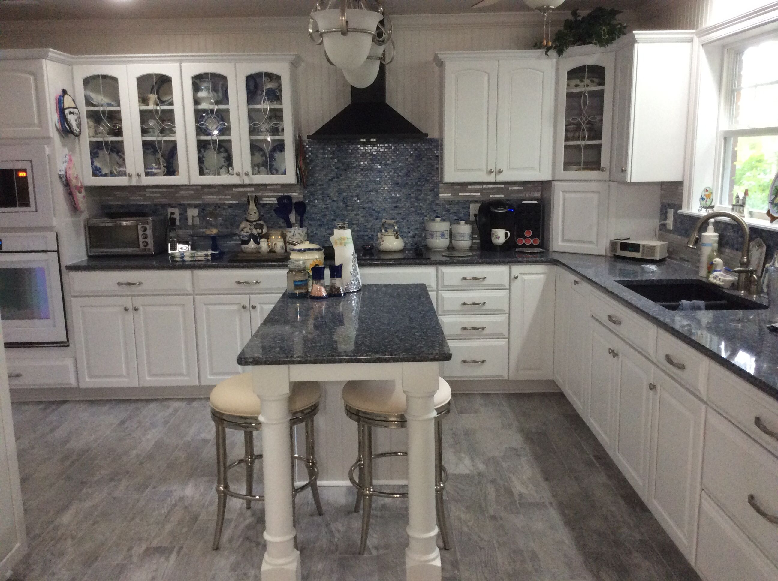 home depot kitchen flooring Blue and white kitchen Cambria Quartz countertop Parys Kraft maid cabinets Home Depot