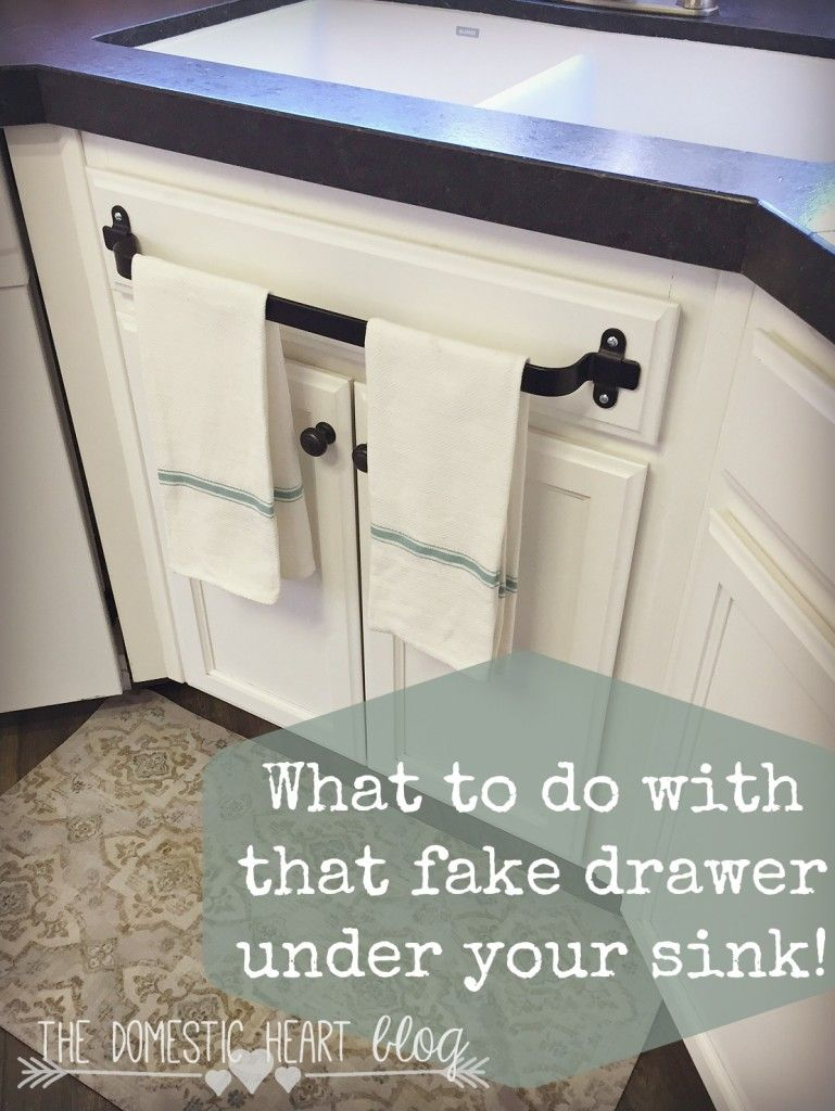 kitchen sink cabinets What to do with that fake drawer under your kitchen sink Kitchen cabinet towel bar