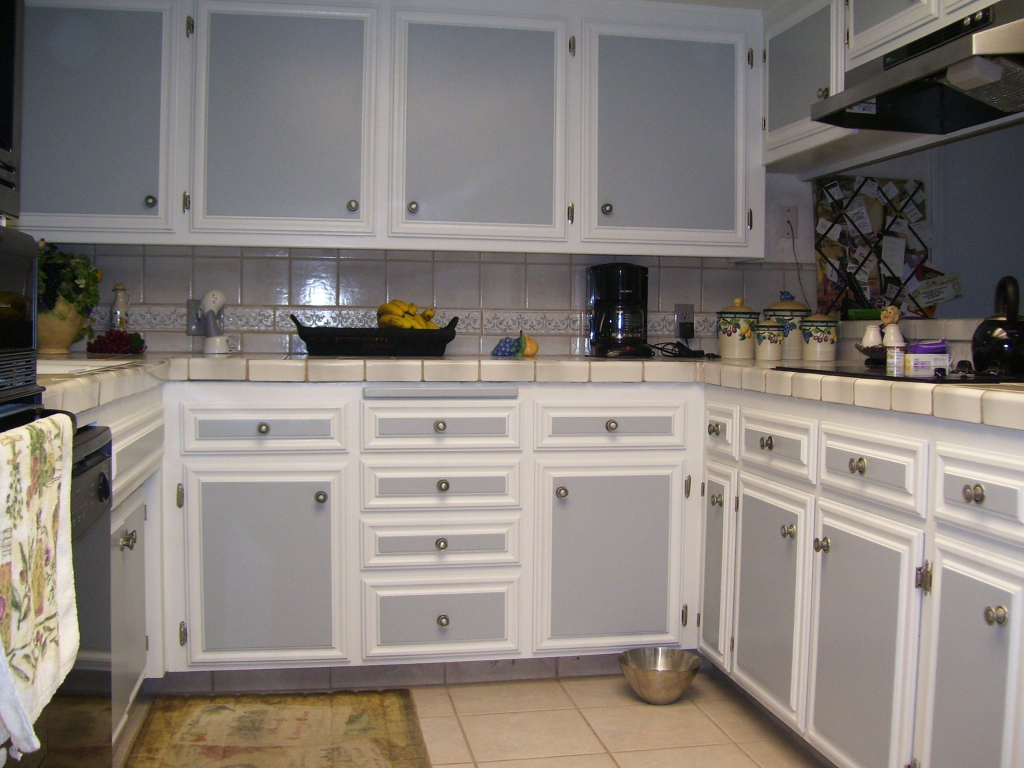 two tone kitchen cabinets Incridible White And Gray Two Tone Kitchen Cabinets With White Ceramic Subway Tiled Backsplash As Well As White Countertop In Small Kitchen Designs