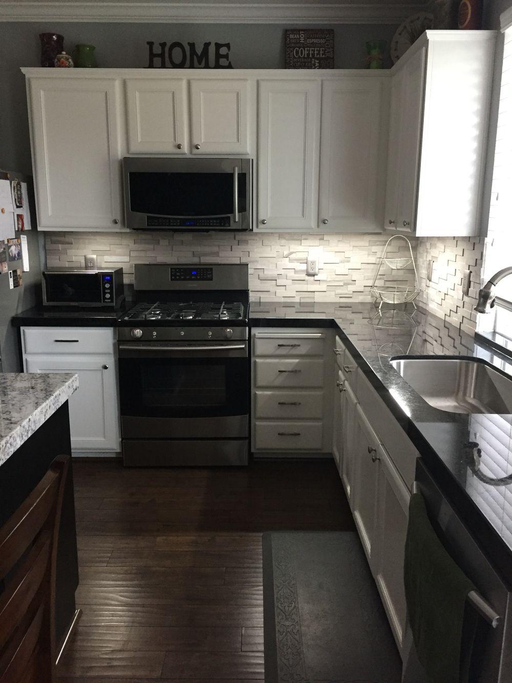 countertops for kitchens Black granite with a gray stone backsplash