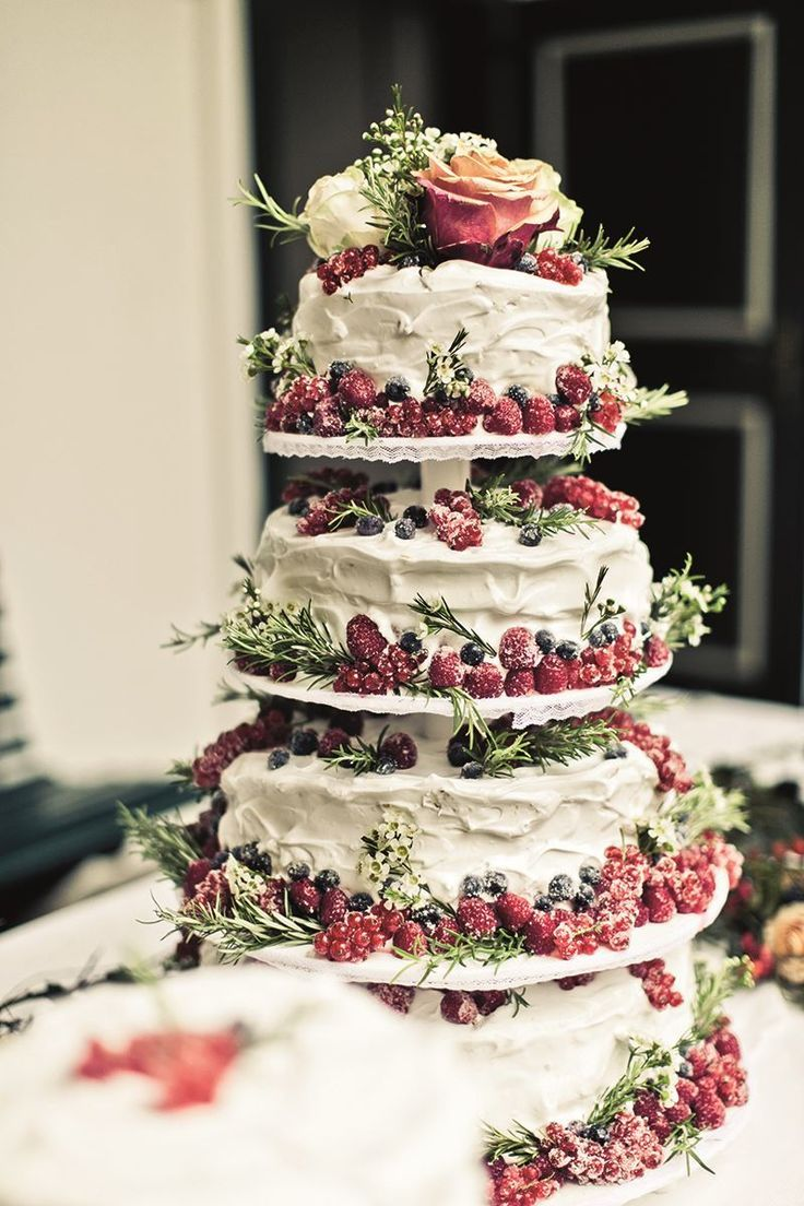 wedding cakes pictures Tiered cake stand with berries for a perfect winter wedding cake