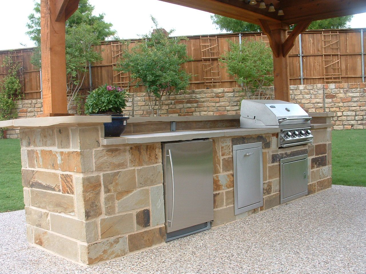 outdoor kitchen ideas outdoor kitchen countertops Wonderful outdoor area with flagstone columns outdoor kitchen countertop decorated with flagstones and potted small green plant there are also built in