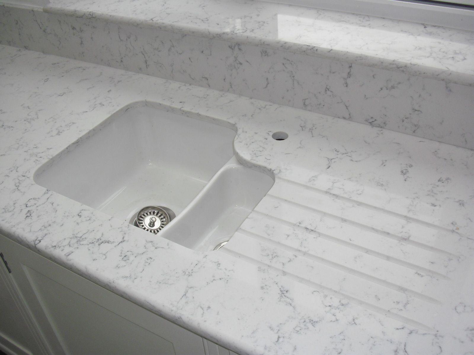 granite quartz worktops white undermount kitchen sink White ceramic undermount sink with Lyra Silestone worktops drainergrooves undersill and