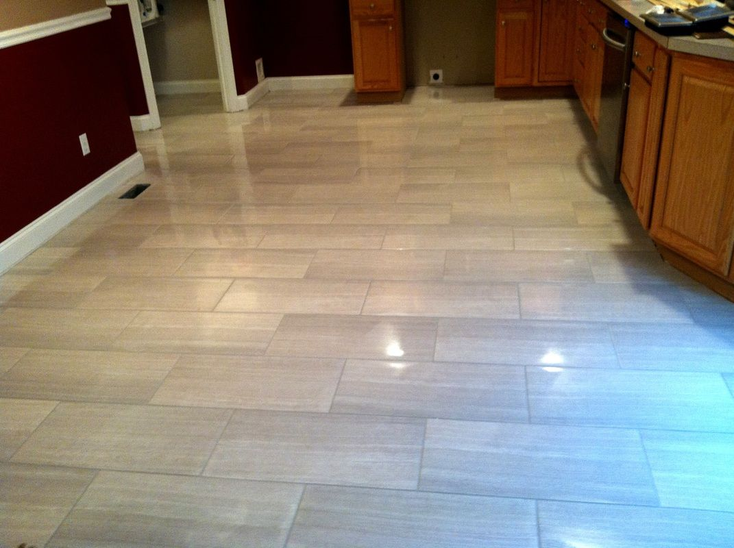 kitchen floors Modern kitchen floor tile by Link Renovations linkrenovations