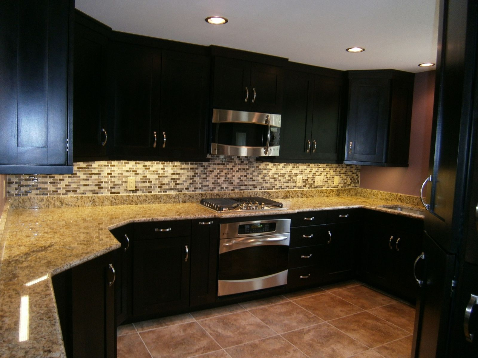 staining kitchen cabinets Excellent White Gray Glass Tile Backsplash And Brown Mosaic Granite Countertop As Well As Cool Espresso Kitchen Cabinets And Microwave Shelves And Ceiling
