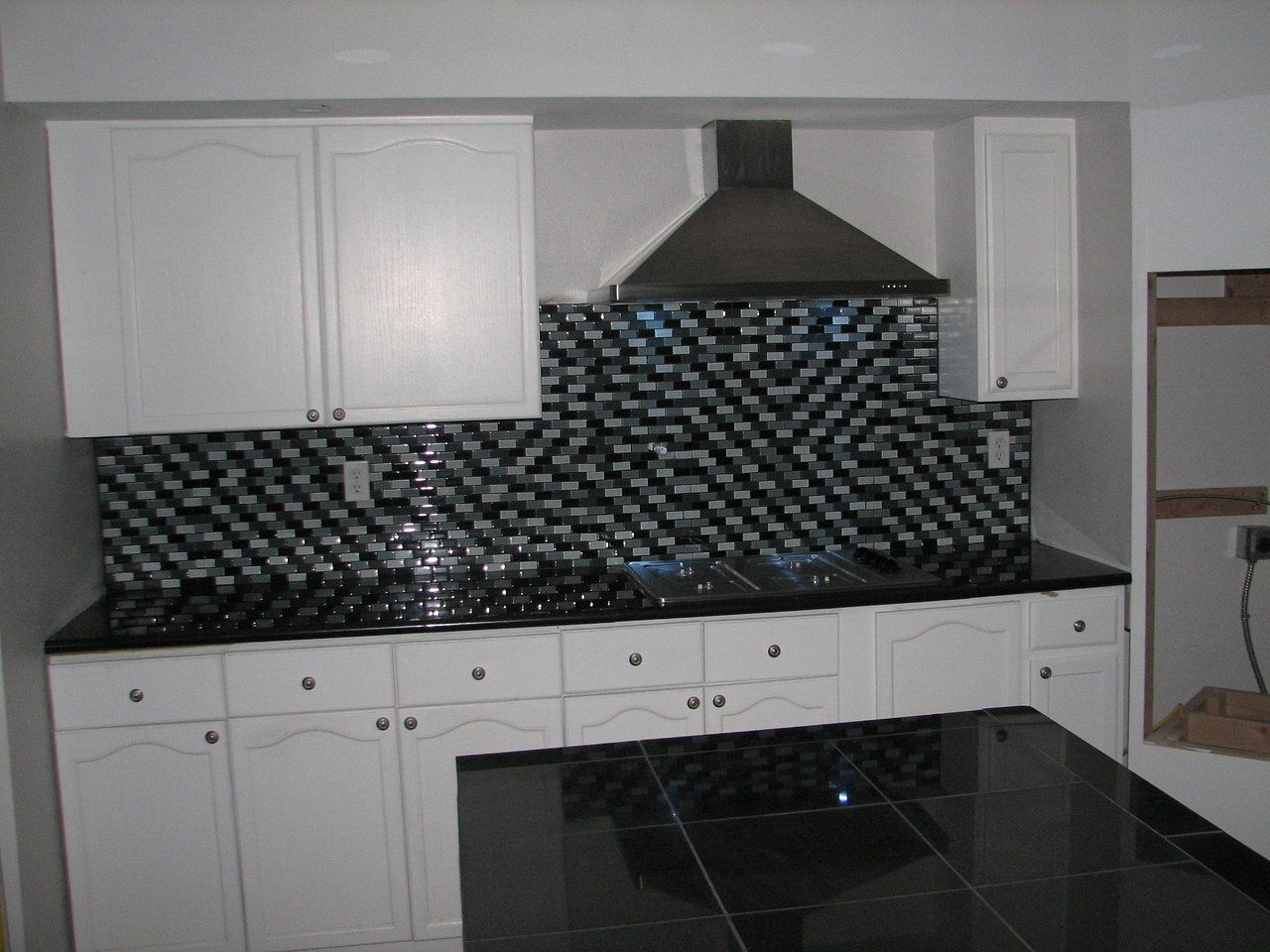 black kitchen countertops Kitchen Countertops finished with Absolute Black Lazy Granite Tiles