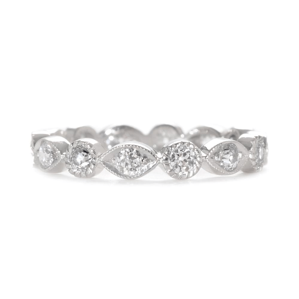 wedding band with diamonds This decorative diamond wedding band features alternating marquis shapes and circles dotted with brilliant pave diamonds