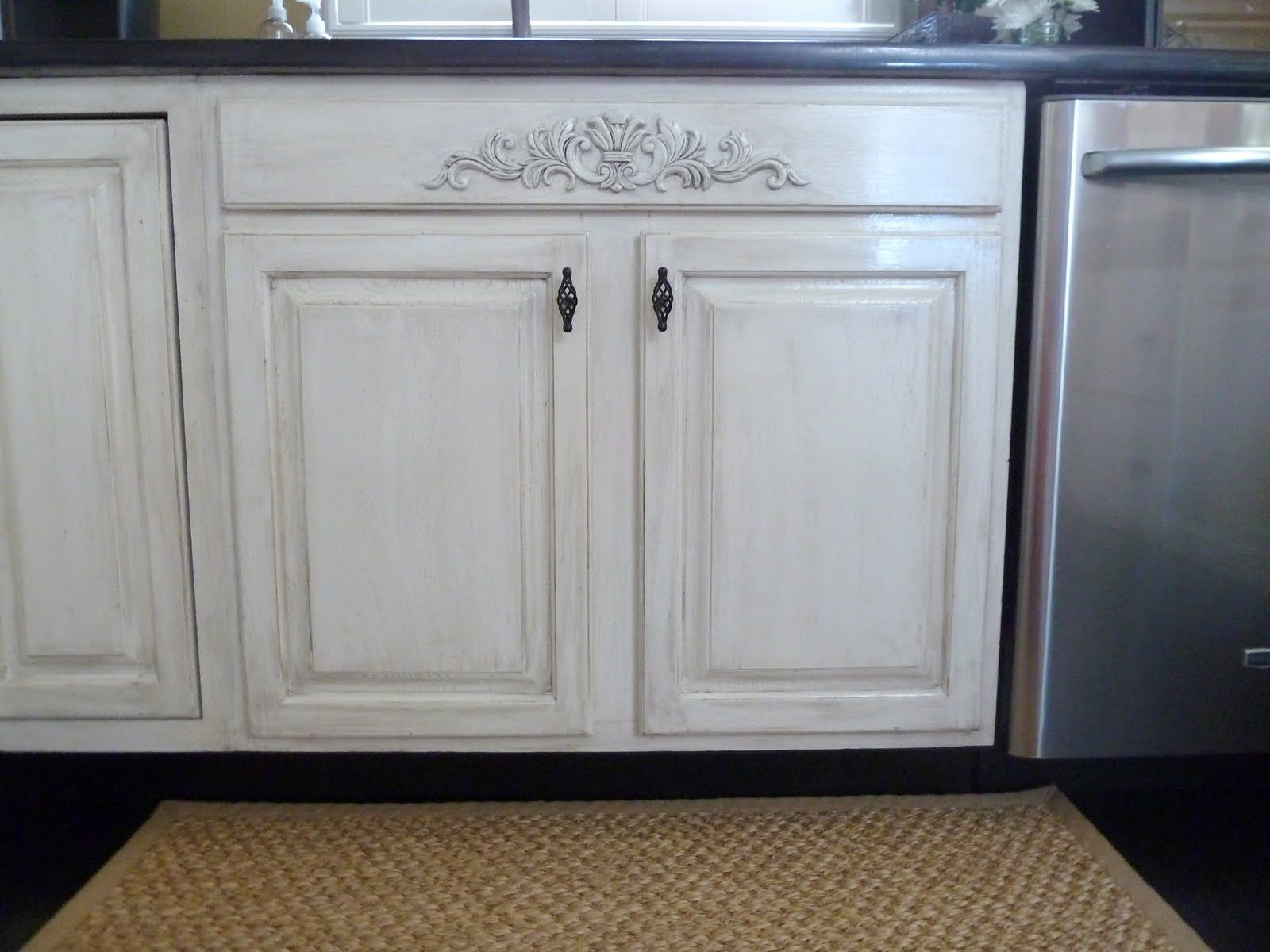 white appliances make it work kitchen cabinets white Distressing white cabinets with glaze and sandpaper Also added a piece of decorative moulding Lowe s to the area under the sink