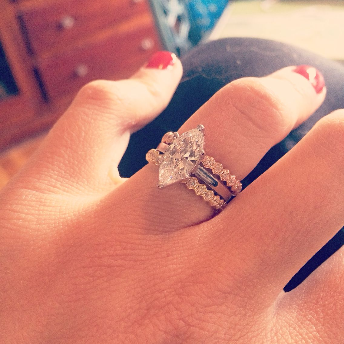 marquee wedding ring Rose gold infinity diamond band and a yellow gold infinity diamond band with a marquee solitaire