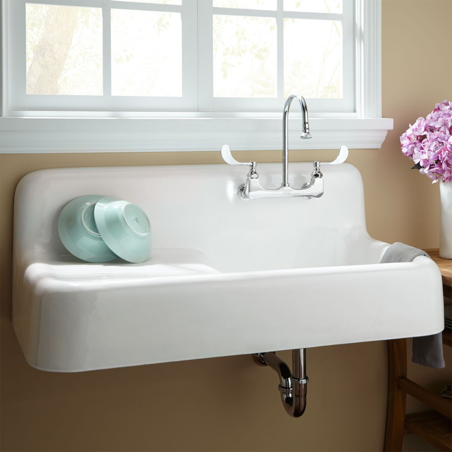 vintage kitchen sink A vintage cast iron kitchen sink with drainboard famous in the s and s How