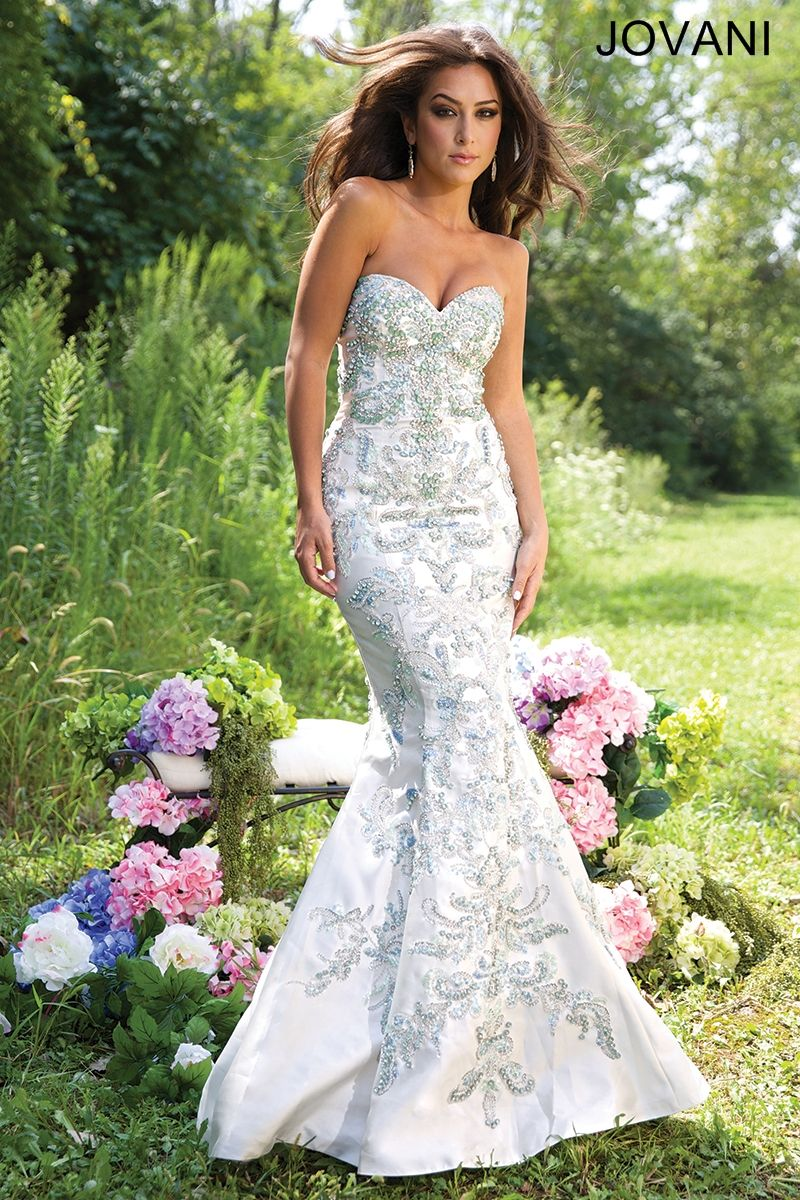 heart shaped wedding dress White mermaid dress with silver embellishments and a heart shaped neckline