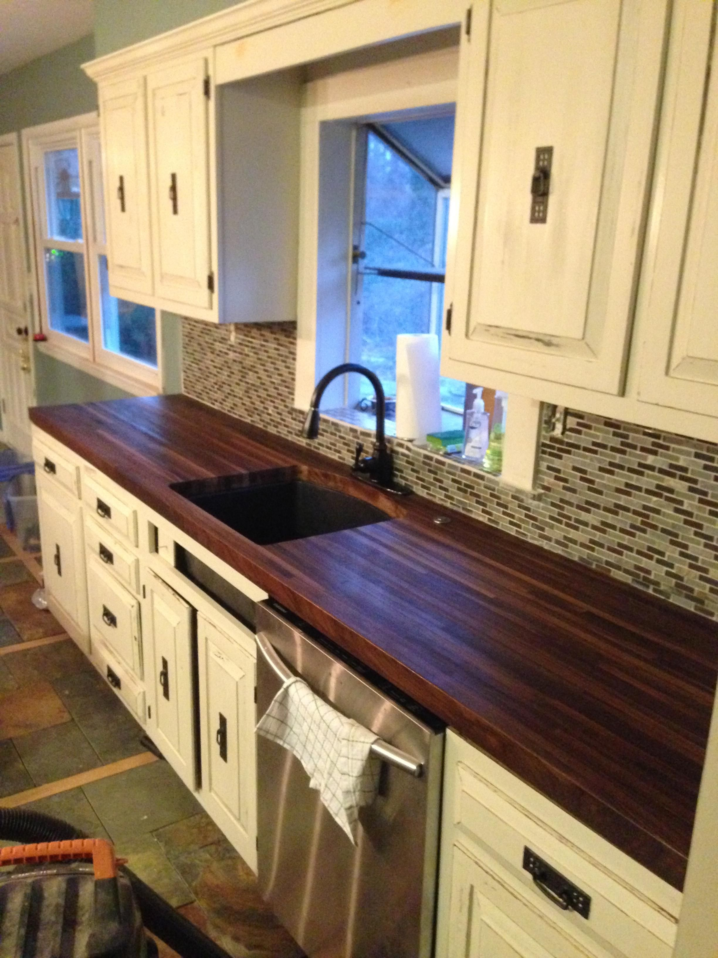 replacing kitchen countertops Built a pair of black walnut butcher block countertops to replace the awful laminate in the house we just bought