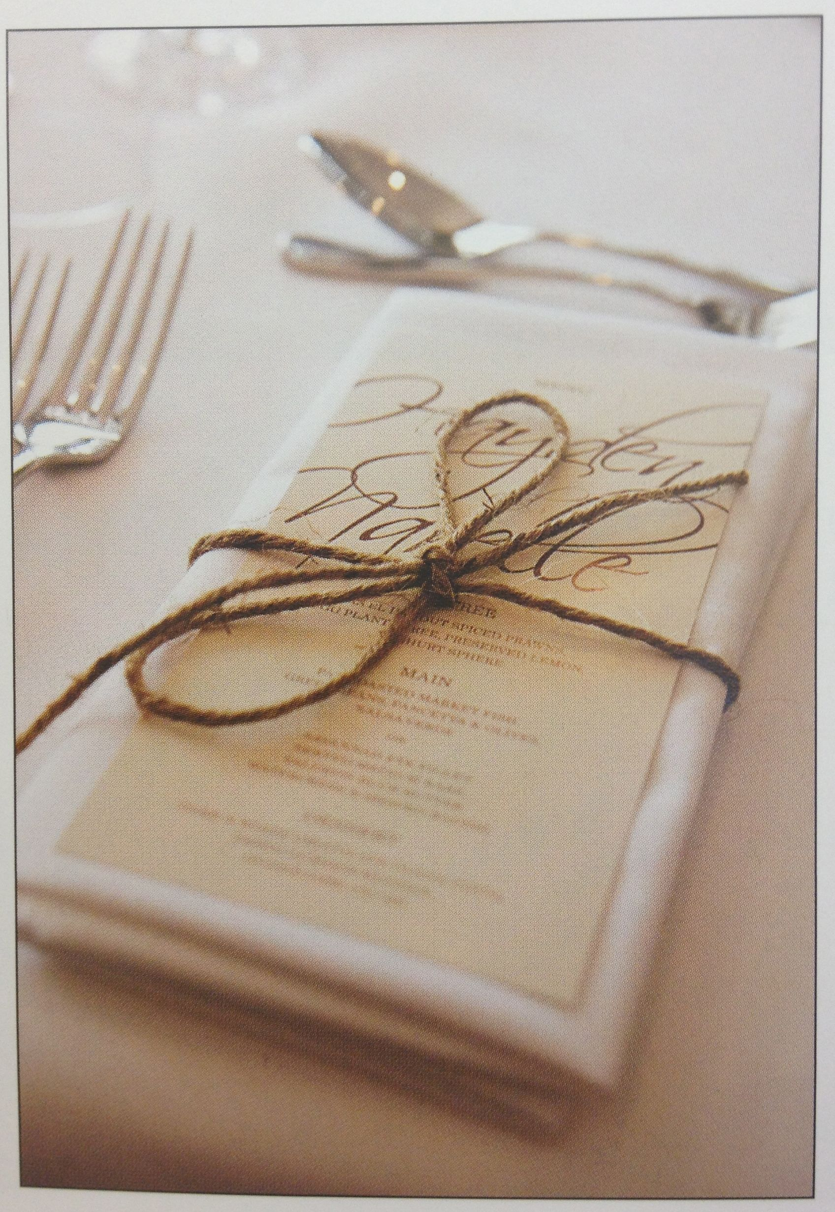 napkins for wedding is simple and easy to make but give a hand created touch place setting tweed or twine tied in a bow with the menu printed and placed on the napkin