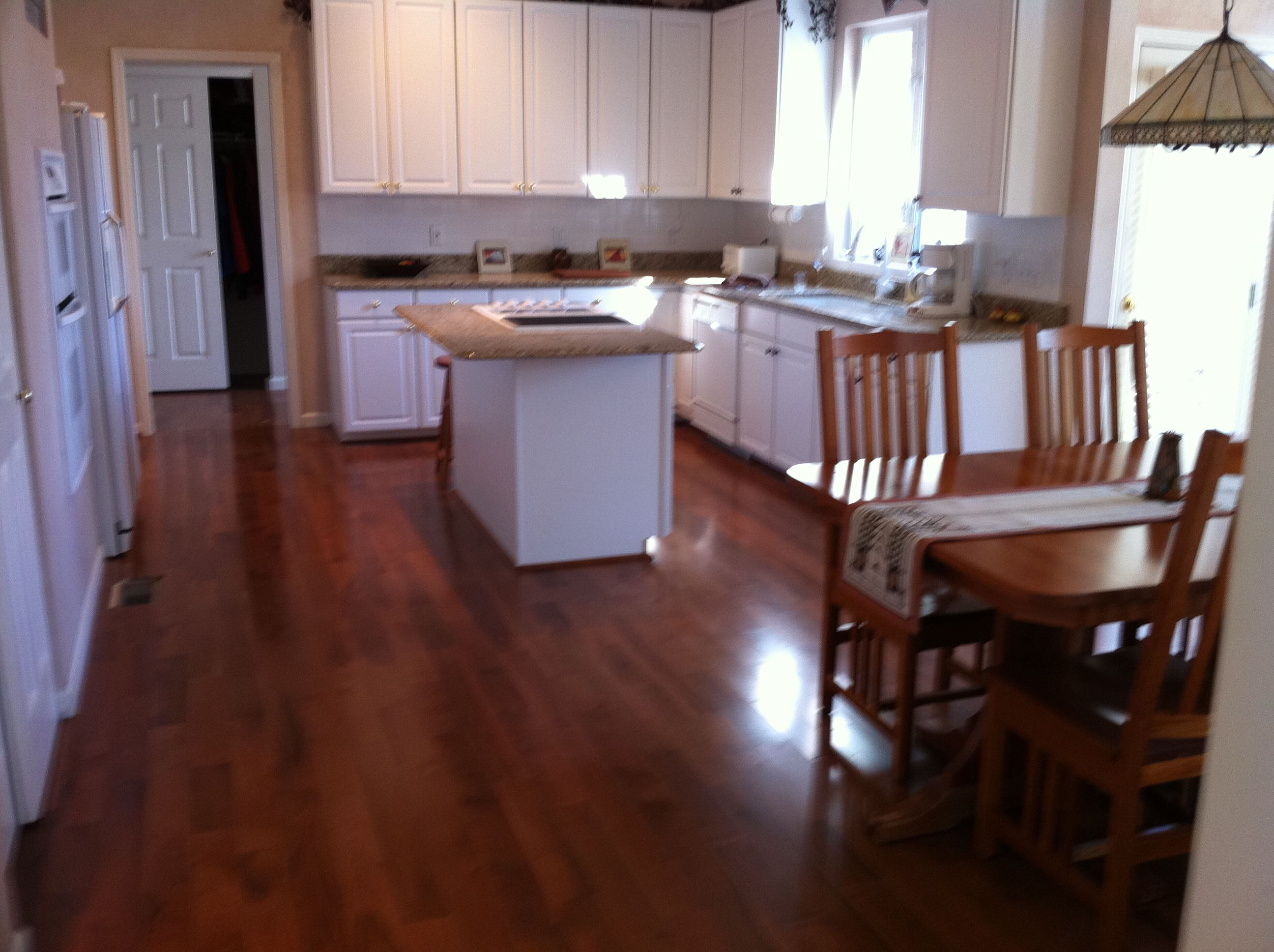 hardwood floors white kitchen dark floors White Kitchen Cabinets with Dark Wood Floors