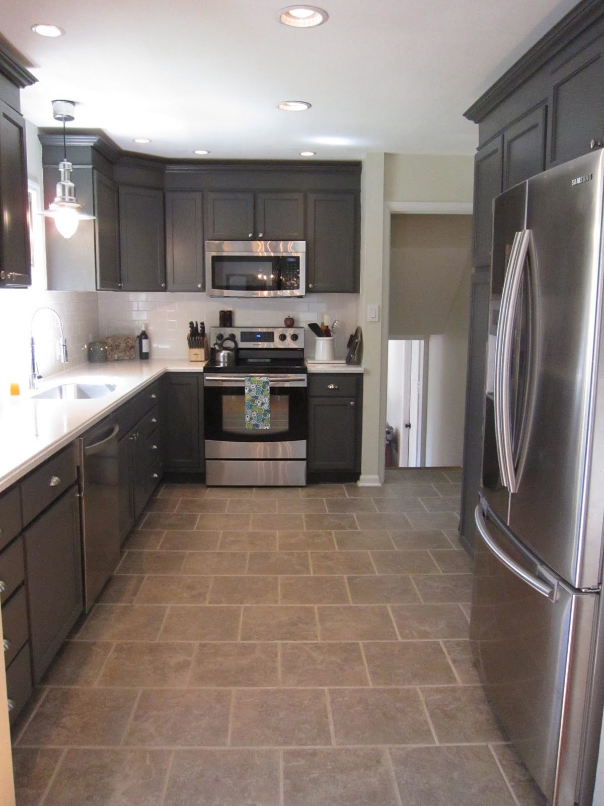gray kitchen floor gray kitchen floor Kitchen Redo With Dark Gray Cabinets White Subway Tile Kitchen Redo With Dark Gray Cabinets