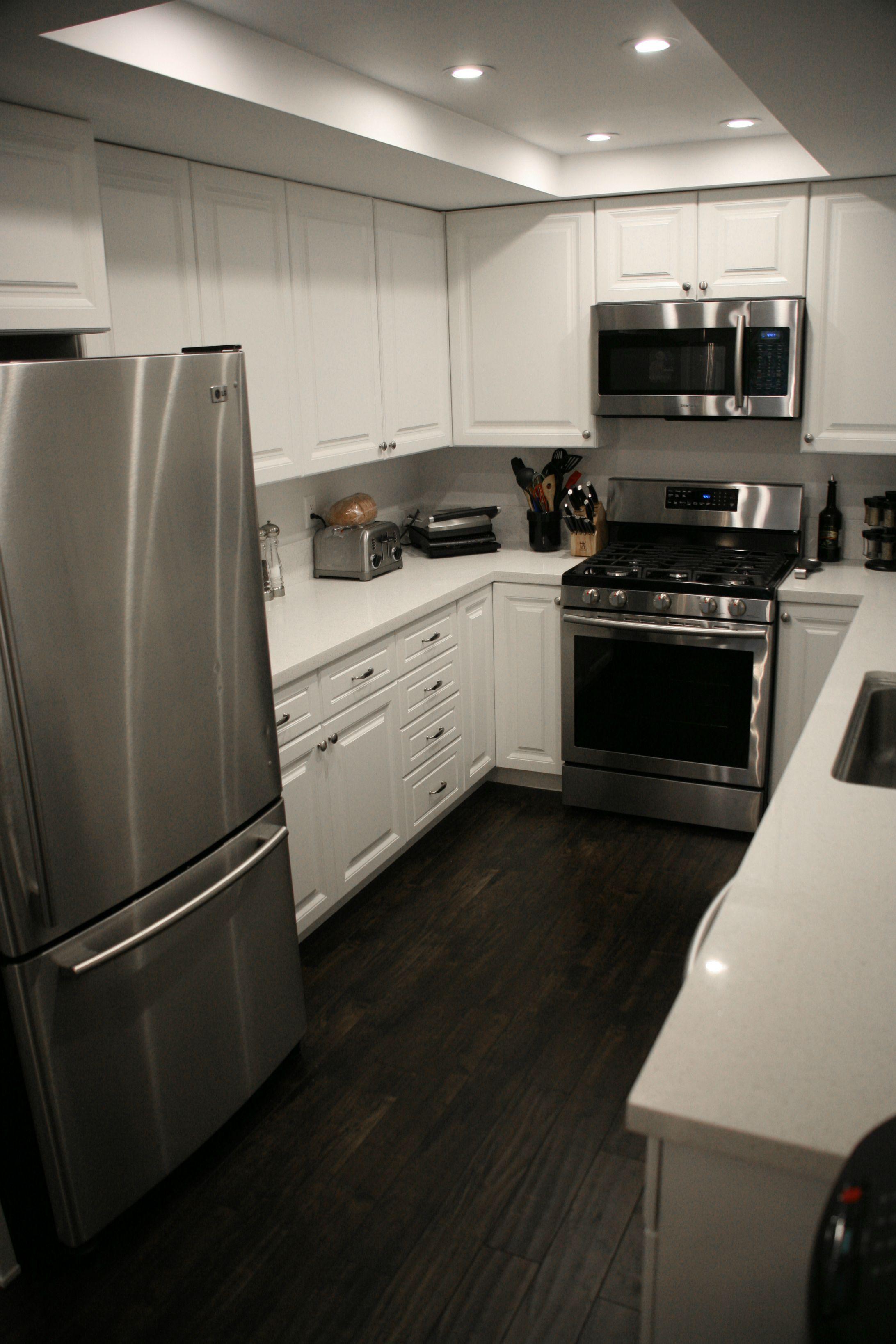 white kitchen dark floors All white White kitchen dark floors