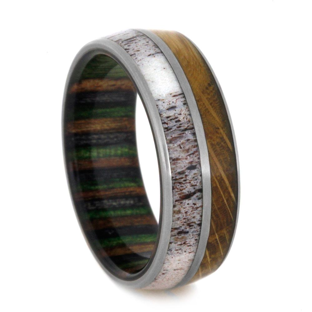 deer wedding bands This titanium wedding band features an abundance of natural character Natural shed deer antler and