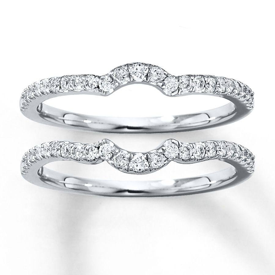 wedding sets A single row of diamonds curves along each of these matching double wedding bands for her Crafted in white gold these rings have a total diamond weight of