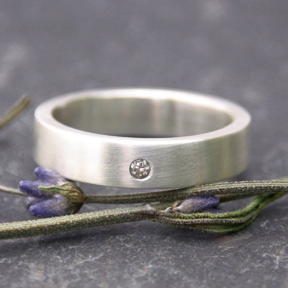 wedding bands for nurses Simple and minimalist a 5mm brushed silver wedding band accented with a small flush set