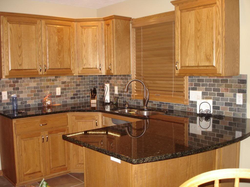 kitchen stone backsplash kitchen honey oak kitchen cabinets with black countertops Pearl or UbaTuba granite countertop