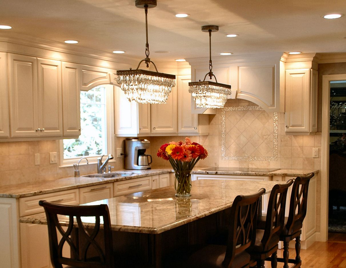 kitchen lights over table two chandeliers over dining table