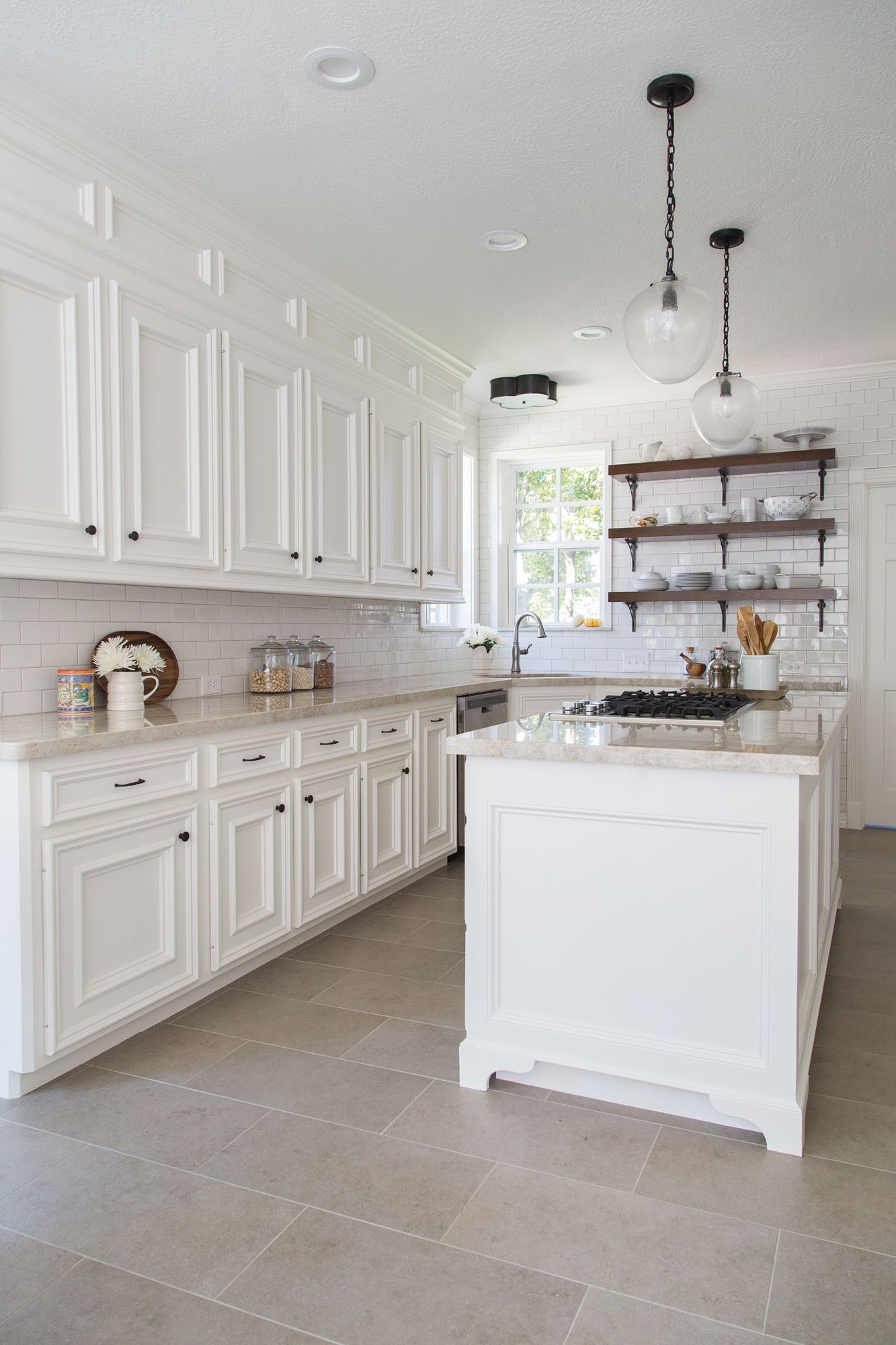 kitchen floor tiles BEFORE AFTER A Dark Dismal Kitchen Is Made Light And Bright Light Flooring KitchenLarge Tile
