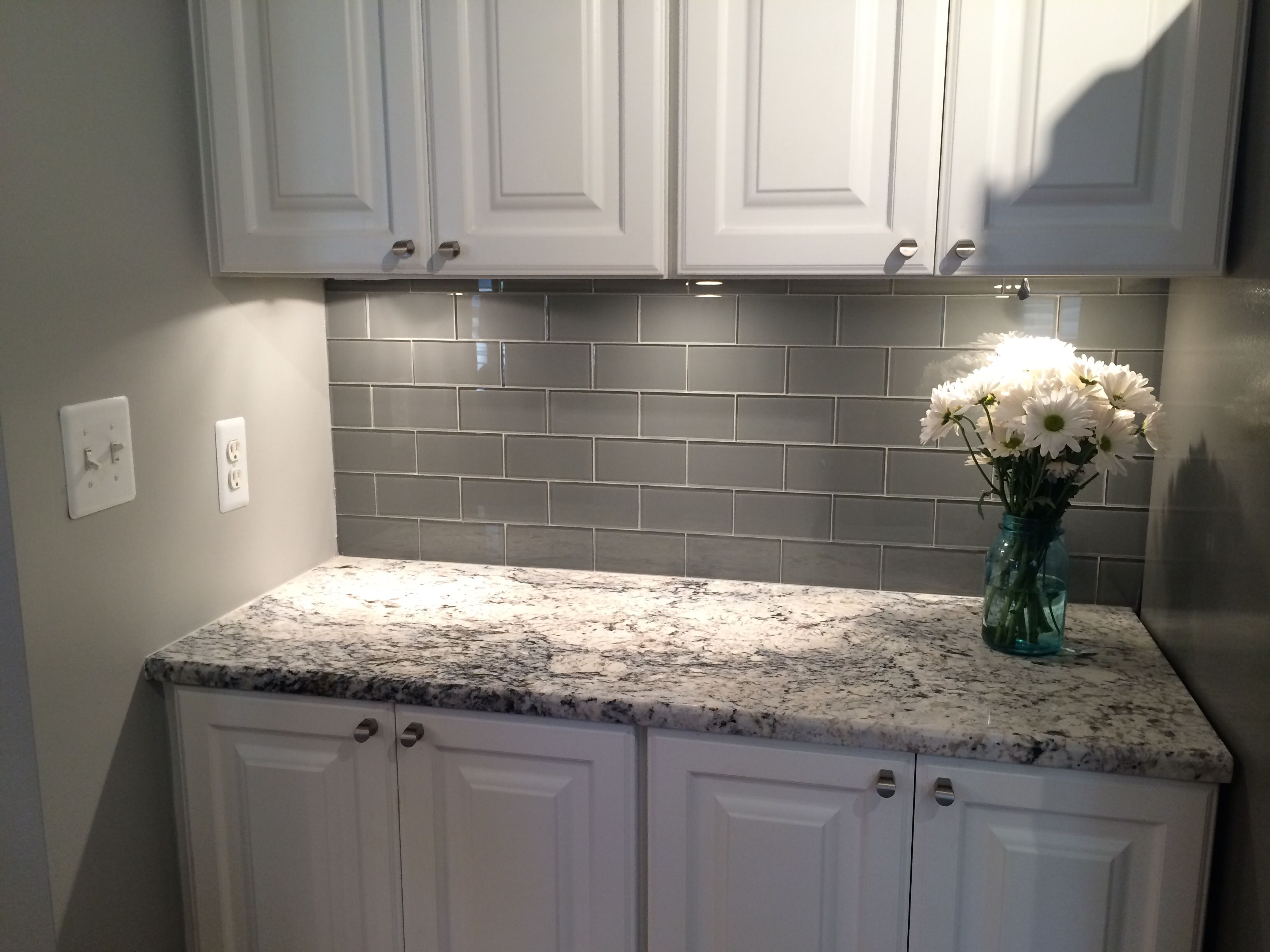 caledonia granite tile kitchen countertops Grey Glass Subway Tile Backsplash And White Cabinet For Small Space