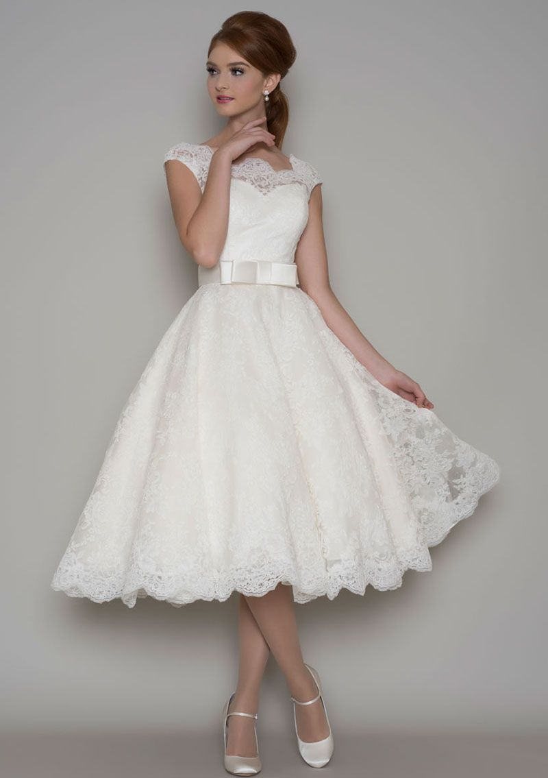 cap sleeve wedding dress This vintage tea length a line wedding dress features strapless sweetheart underskirt skirt with illusion Cap Sleeve