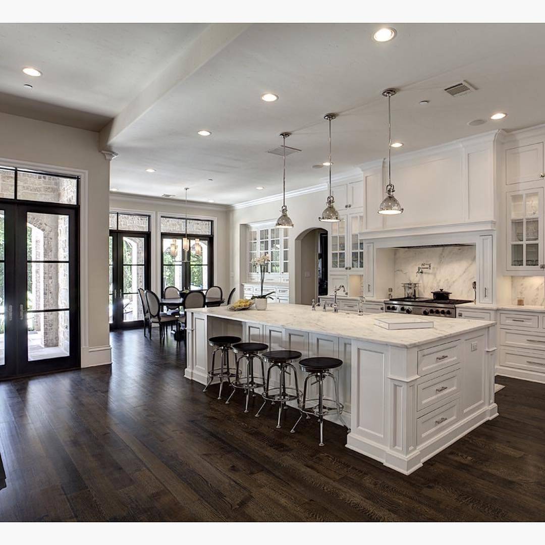 wood floor kitchen Love the contrast of white and dark wood floors By Simmons Estate Homes