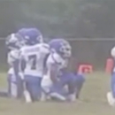St. Louis youth football team kneels during anthem. (Facebook) e172e4283