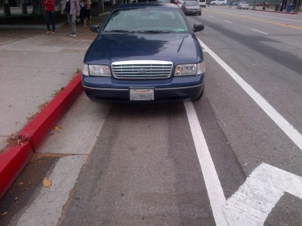 Car parked on bike lane.
