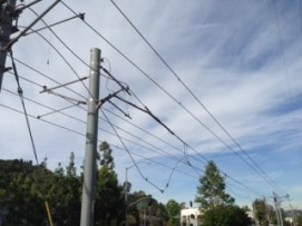 A broken support on the overheard wire system.
