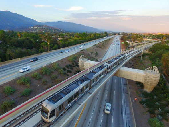 A Gold Line test train heads over the eastbound 210 toward Arcadia Station.