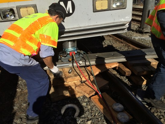 Getting the train back on track so it can be moved for further investigation.