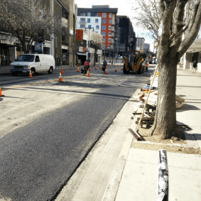 Paving along 2nd Street after utility relocation work.