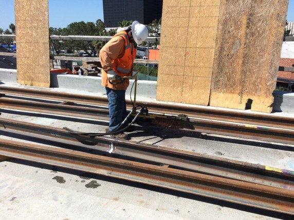 Grinding of welded rail for placement near Century Blvd. and Aviation Blvd.