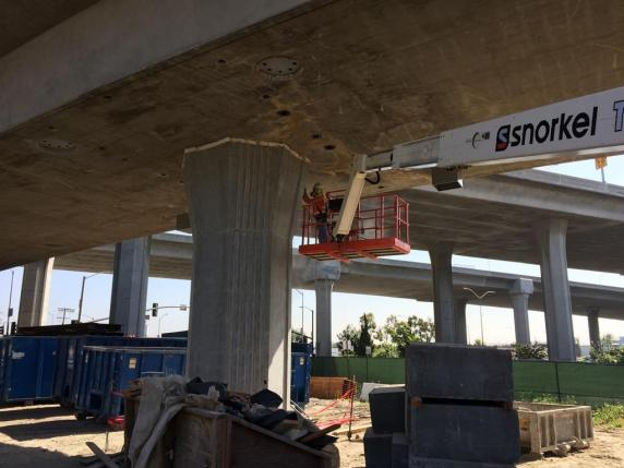 Surface finish work on the structure that will carry Crenshaw/LAX tracks to a junction with the Green Line.