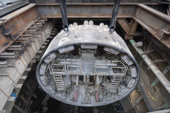 Each segment of the tunnel boring machine shield is disassembled and extracted. Photo by Ken Karagozian.