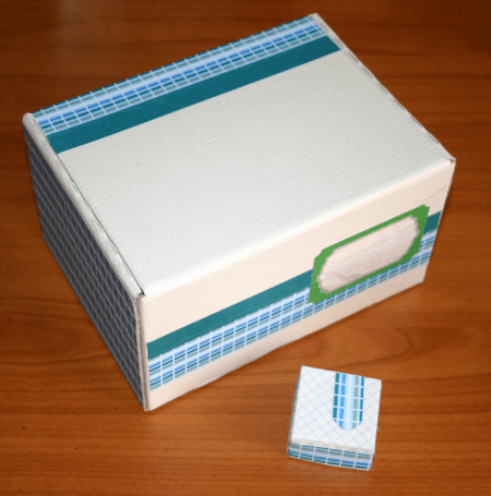 White box decorated with blue paper