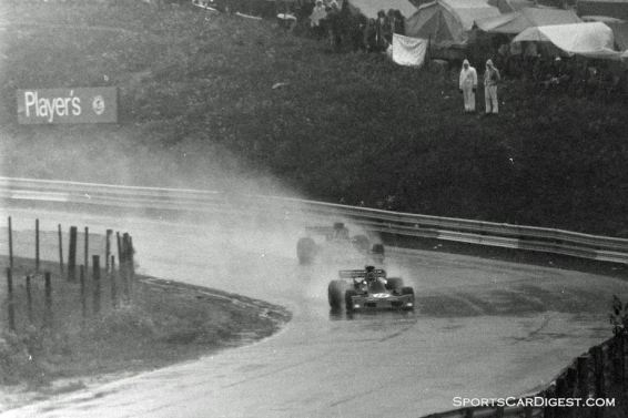 Jean-Pierre Jarier ahead of someone fighting the mist off his tires